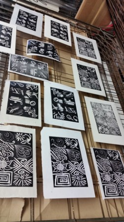 Mark making proof prints drying on the rack